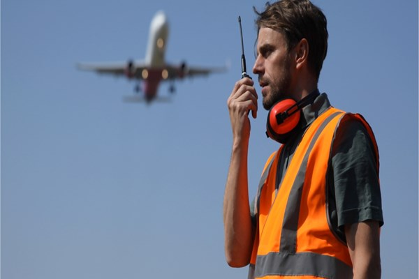 Airport worker on Hand-held Radio